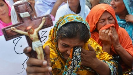 """Punjab Province is where most of the worst violence against the Pakistan's Christian community has taken place. That includes a rampage in 1997 by a large Muslim mob that burned down an entire Christian village, leaving its 20,000 residents homeless. It also includes a wave of violence on March 9, 2013, when a Muslim mob burned down more than 170 houses, 16 shops, and two churches in a Christian neighborhood of Lahore, the Punjab capital. It later emerged that the violence was sparked by a Muslim man who, seeking to escalate a dispute with a Christian acquaintance, accused him of insulting the Prophet Muhammad. Extremist Focus The double suicide bombing at the All Saints Church in Peshawar, capital of the northwestern Khyber Pakhtunkhwa Province, has stoked fears and concerns that anti-Christian violence is spreading beyond Punjab. The Peshawar bombings killed at least 81 people, making it the worst attack against Peshawar's Christian community in a century and one of the deadliest attacks in years against Christians anywhere in the country. A faction of Pakistan's umbrella Taliban movement, Junood ul-Hifsa, claimed responsibility for the attacks, saying it was to avenge U.S. drone strikes in the country's tribal areas. Martin Javed Miachal is the chairman of the Pakistan Christian Movement. He told RFE/RL's Radio Mashaal that Christians have become so frightened in Pakistan that thousands are leaving the country every year -- with most going to refugee camps in Thailand, Sri Lanka, and Malaysia. He described the lives of Pakistani Christians as """"hopeless and helpless,"""" adding, """"Our future in Pakistan is very dark."""" Peter Jacob is a Christian lawyer in Pakistan who heads a Roman Catholic organization called the National Commission for Peace and Justice. Even before the deadly September 22 attack in Peshawar, Jacob had counted more than 120 attacks against Christians in Pakistan since 1997. Jacob says most recent attacks against Pakistani Christians have been carried"""