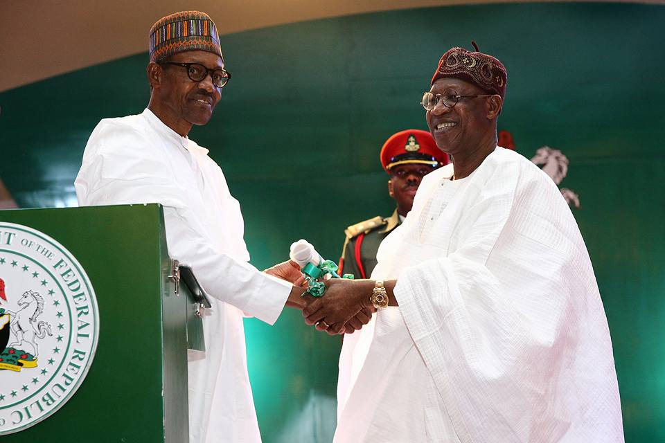 President Buhari hands over the Message of CHANGE to the Minister of Information & Culture Alhaji Lai Mohammed at the Launch of the National Re-Orientation Campaign at the State House Conference Centre on 8th Sep 2016. | State House Photo