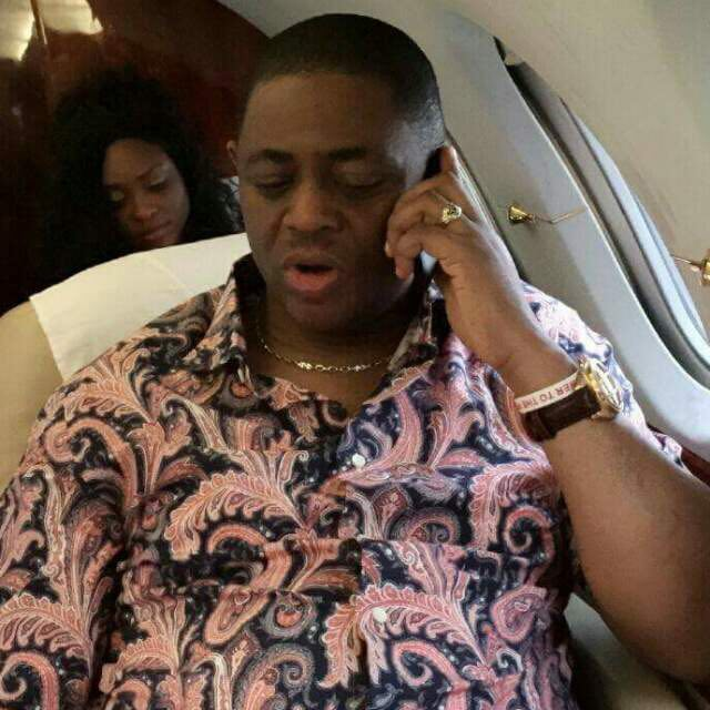 Image result for photos of femi fani kayode making phone call