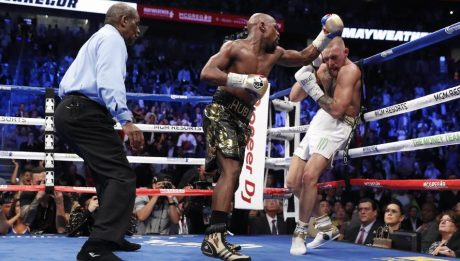 Mayweather wins, referee saves McGregor