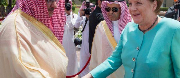 Saudi King Shaking Hands With Germany's Angela Merkel