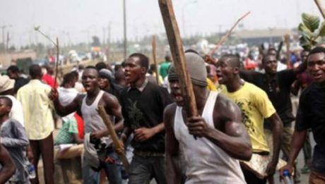 Mob Burns Mentally Challenged Caught With AK47s