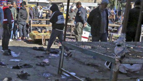 Iraq market blast kills at least 21, wounds 33